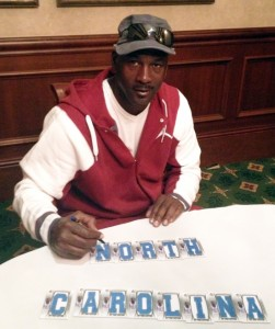 Michael-Jordan-Signs-for-Upper-Deck-2013-SP-Authentic-Basketball