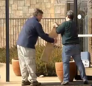KATV image of FBI agents removing boxes from Rogers Photo Archive