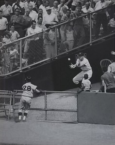 Yankee in the bullpen catching a Yogi Berra home run at Yankee Stadium.