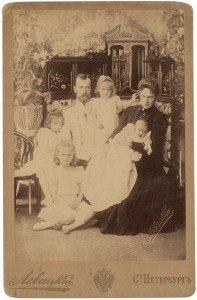 Original Russian early 1900s cabinet card of the doomed Romanov family, including Czar Nicholos and Anastasia.  A quaint family portrait with all the text on the cabinet in Russian.