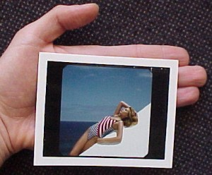 Rare polaroid test photo of swimsuit model Bridget Hall by famous French fashion photographer Elles Bensimon.  This diminutive and unique photo is a production item from  the making of the 1995 Bridget Hall Calendar. It was used  to test the lighting  before the formal shooting.