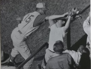 Cincinnati Reds' George Crow fighting a fan over a foul ball.