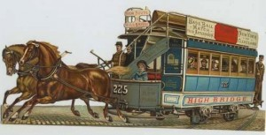 New York Giants and Cleveland Spiders die cut, with a horse-drawn trolley leading the way to the Polo Grounds.