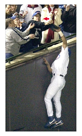 Steve Bartman (in dark shirt) attempting to catch foul pop in 2003 NLCS