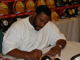 Former Pittsburgh Steelers running back Jerome Bettis signing for B & G