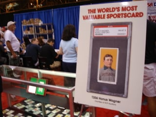 T206 Wagner graded PSA 8 is on display outside the company's booth